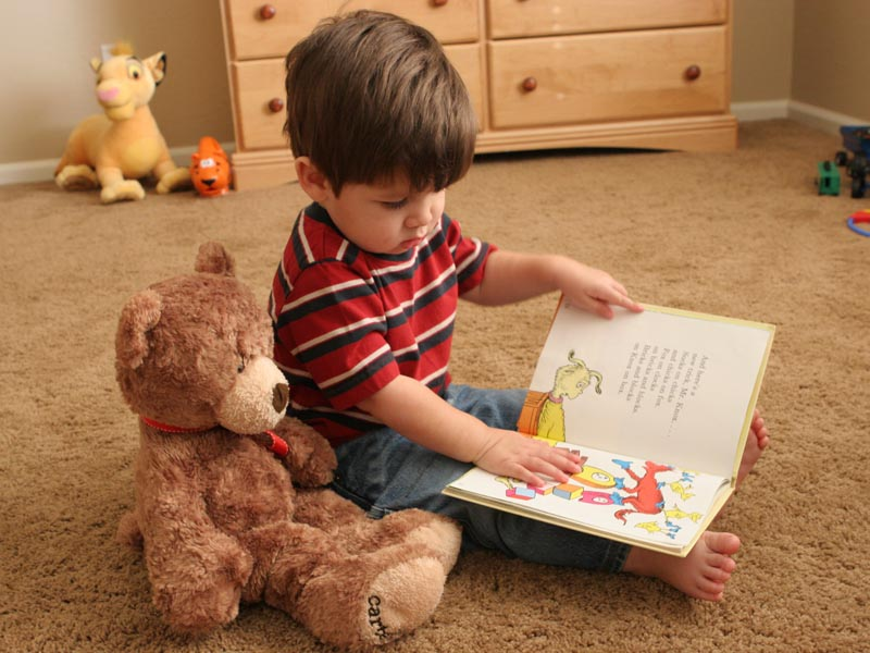 jared_reading_to_teddy_022006-759056.jpg